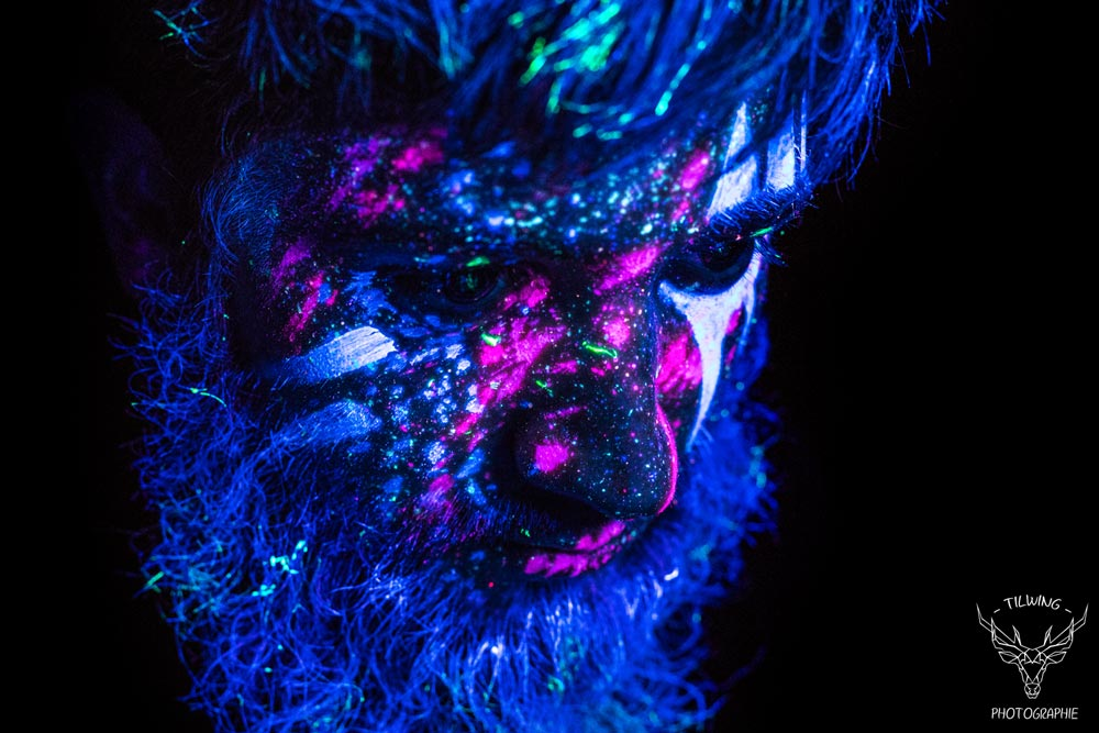 black light body painting tribal portrait